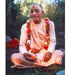 Srila Prabhupada in France, Holding a Marigold Flower