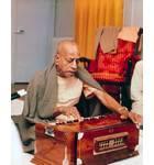 Srila Prabhupada Playing Harmonium